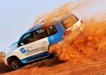 Abu Dhabi: 7-Hours Desert Safari with BBQ, Camel Ride & Sandboarding. Abu Dabi, United Arab Emirates