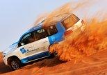 Abu Dhabi: 7-Hours Desert Safari with BBQ, Camel Ride & Sandboarding,
