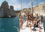 Discover Milos, sailing, snorkelling and cave exploration cruise, in small group. Milos, Greece