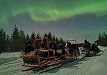Northern Lights Sledge Ride By Snowmobile. Rovaniemi, FINLAND