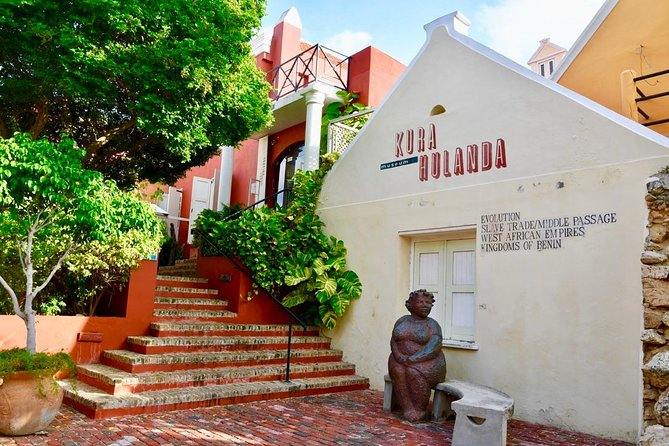 """Museum Kurá Hulanda is situated right at the city-center harbor of Willemstad, where Dutch entrepreneurs once traded and transshipped enslaved Africans along with other """"commercial goods"""".<br><br>This museum impressively exhibits the Trans-Atlantic Slave Trade in its totally, from slave capture in Africa through the Middle Passage and relocation in the New World.<br><br>Museum Kurá Hulanda further exhibits a vast collection of artifacts from continental Africa, showing the dynamic vitality and great Empires of West Africa, which in the largest collection of African artifacts in the Caribbean.<br>"""