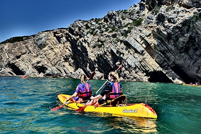 Spend an exciting day on the water with this 3-hour guided kayak tour of the Sesimbra coast. You will be amazed with the Cliffs, caves and tunnels that characterize Sesimbra's Natural Park. You will reach and stop at one of the most beautifull beaches in Portugal, Ribeira do Cavalo.<br>A professional kayak guide will provide all the necessary gear before leading you on a gorgeous tour.<br>We can pick you up in Lisbon centre and cross the Tagus River and the 25th of April bridge, we will take you to Sesimbra where you will kayak along the coast of Arrabida Nature Park and learn about the natural geology of the Luiz de Saldanha Maritime Reserve. If you find it easier to come by yourself, you will meet us on our Kayak and Outdoor Centre in Sesimbra's harbour. You'll kayak a total distance of between 6-10 kilometers full of beauty and nature sightseeing!