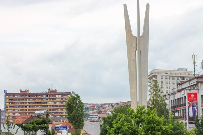 """A walking tour through the capital Pristina exploring its main attractions in the centre and surroundings including: the Mother Teresa Boulevard, the monument of Scanderbeg (Albanian National Hero), the Clock Tower, Kosovo Government buildings and the """"New Born"""" monument which is becoming the symbol of this new state."""