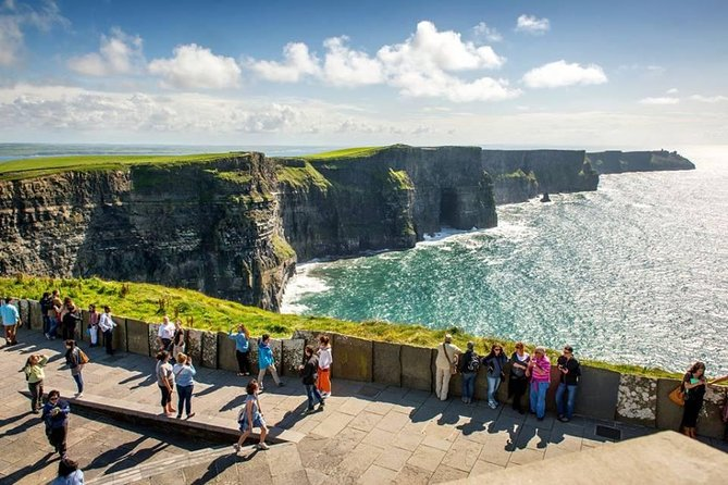 This breath taking scenic tour includes 2 hours at the iconic Cliffs of Moher, to explore, walk, photograph, relax and take in all this world famous site has to offer. Departing Galway, your local driver guide heads to the western coastline's famous touring route-the Wild Atlantic Way, travelling past harbours, working farms, medieval ruins, 16th-century tower houses and stone churches. Our 1st stop is the medieval Dunguaire Castle, then onto the glacio-karst landscape of the Burren, passing the 12th century Cistercian Corcomroe Abbey. Following the Wild Atlantic way, we start to see the 3 Aran Islands. Onto Doolin pier for a photo stop and a chance to feel the wild Atlantic wind in your face. Then time for lunch at Doolin Hotel-try their delicious local sea food dishes! Arriving at the Cliffs of Moher, take a stroll along the summit of the Cliffs and witness the spectacular views of huge ocean and sky. We return to Galway via Lisdoonvarna, famous for its annual match making festival.