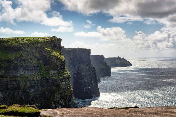 Come discover the world famous Cliffs of Moher on the scenic coastal Wild Atlantic Way route. If you're into walking, photography, exploring, or quite simply just wish to take your time, breathe in the invigorating Atlantic sea air and witness these iconic Cliffs, this is the tour for you. Your local driver/guide will take you on a fascinating journey along the Wild Atlantic Way, through the lunar-like landscape of the Burren and on to the Cliffs of Moher.Heading towards the Cliffs you will pass through the picturesque Irish villages, see medieval ruins, 16th-century tower-house castles, Abbeys, churches, graveyards, dry stone walls, quays and harbours, ponies, horses, calves, cows, lambs and sheep.