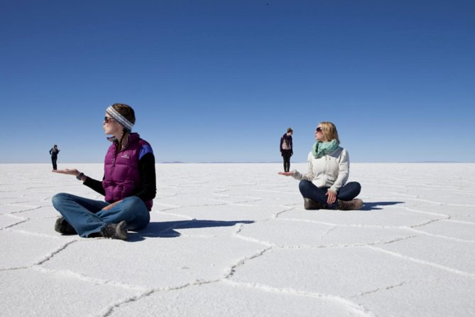 Depart La Paz for an unforgettable expedition through the vast and blinding-white salt flats of Uyuni and into the desert of southwest Bolivia. Along the way, visit tiny villages, salt hostels, multi-colored lakes with flamingos, geysers, and thermal hot-springs at 4,000 - 5,000m.<br><br>Highlights:<br>- Take wacky pictures in the famous Salar de Uyuni<br>- Drive through the Bolivian Altiplano's moon-like deserts<br>- Marvel at breathtaking red and green colored lakes<br>- See active volcanoes and relax in therapeutic hot springs