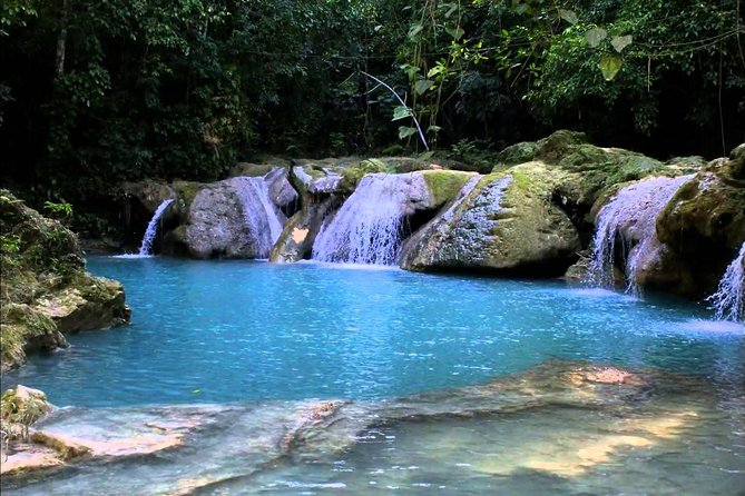 Visit two of Jamaica's most popular natural attractions, Blue Hole and River Rapids, for an amazing 6-hour excursion from Falmouth cruise port. Once your guide picks you up from the port, you will be taken on a scenic drive along the North Coast to visit the Blue Hole in Ocho Rios for some waterfall climbing, rope swinging, and swimming. Then, your guide/driver will take you to River Rapids Adventures, where you will have a Jamaican lunch on the beach, before heading up to the Rio Bueno River, where you can choose to float downstream in a raft, tube, or kayak. Once your river adventure is completed, you will arrive back at the beach where you can buy drinks (out of pocket) or use the photo stand (out of pocket), before its time to head back to the cruise port.