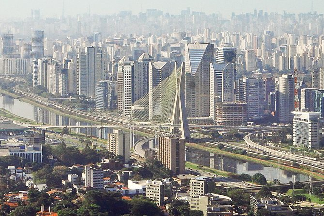 If you are on a layover at São Paulo Guarulhos International Airport, rather than spending hours waiting for your flight, you can book this tour to visit São Paulo's top attractions. You'll cover a lot of ground with this private city tour by vehicle and on foot! <br><br>Your informative local guide will accompany you on a walk through São Paulo's historical downtown, and take you on a scenic drive through several city neighborhoods. <br><br>Enjoy guided commentary on 10 or more major landmarks including airport pickup and drop-off.