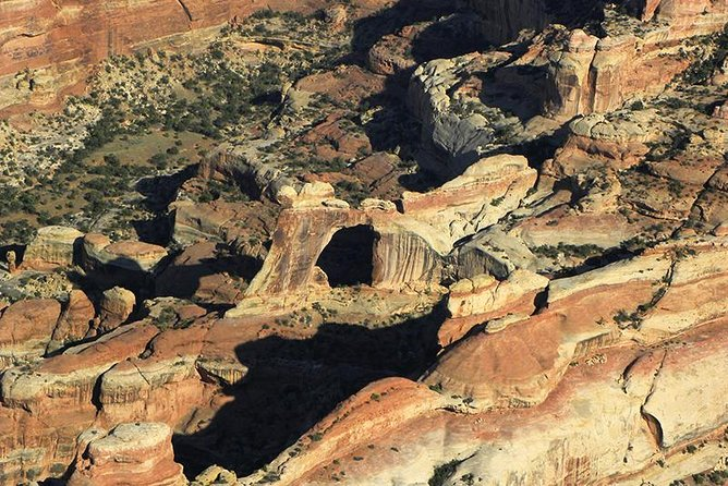 This spectacular Redtail Air Adventures flight will carry you above the fantastic scenery of Canyonlands National Park. Majestic 1000-foot high cliffs rise above the Colorado and Green Rivers, which border it on either side. Serpentine drainage systems are carved into the terrain below the cliffs. Upheaval Dome can be seen at its northern end; the Confluence of the the two rivers form the district's southernmost point. Then on to the Needles District, the most fanciful and colorful portion of Canyonlands. Pink and white bands can be seen in its many spires and cliffs, and it is the home of some of the most remote and famous arches of canyon country. Difficult to reach by hiking and extremely beautiful, Angel Arch and Druid Arches are the best known. Elephant Arch, Kirk Arch, Wedding Ring Arch and Castle Arch, hidden away in the back country, are also included. Photographic opportunities abound!
