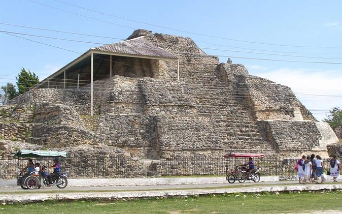 """Depart early from your Merida hotel and commence the journey to Mayapan in a comfortable and air-conditioned minivan. You will visit with a certificated guide. Acanceh was founded sometime between 200 and 300, during the Early Classic period. Three of these buildings have been restored and are open to the public, although recent excavations have uncovered more structures. The three-leveled step pyramid in Acanceh is 11 meters high. One of the older layers of the pyramid has been uncovered revealing several distinctive carved masks as part of the pyramid's decoration. The """"Palace of the Stuccos"""" is 50 meters wide, 6 meters high, and contains many elaborate friezes. This building's design is very complex, with many rooms and detailed carvings. To conclude the tour you'll visit the cenote, there you will swim for many minutes. Then you'll arrive to Merida City at 17:00 hrs approximately"""