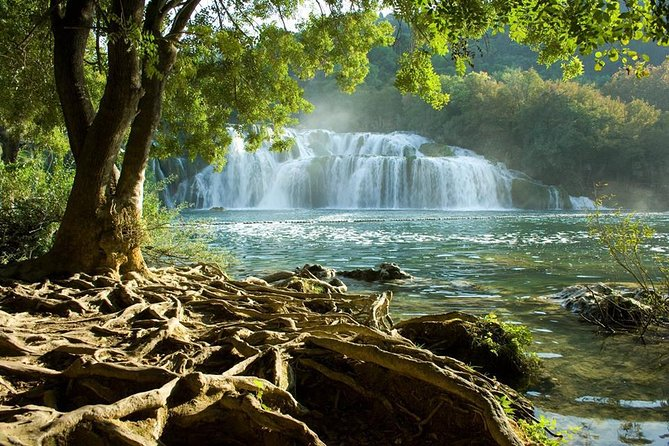 Small-group trip to the National Park Krka Waterfalls and wine tasting at Ranch Rak. Experience beautiful nature and the grapes of Croatia with all your senses.