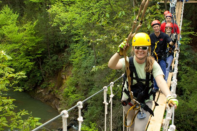Experience a world-class tree-top zip line canopy tour through the endangered hemlock forest of West Virginia's New River Gorge. With seven zip lines ranging from 150- 640 feet, four sky bridges and a rappel, get a bird's eye view of the forest below as you zip across Mill Creek and visit places inaccessible any other way. Tours include up to 6 guests with 2 certified guides. A weight restriction of 90-260 pounds applies.