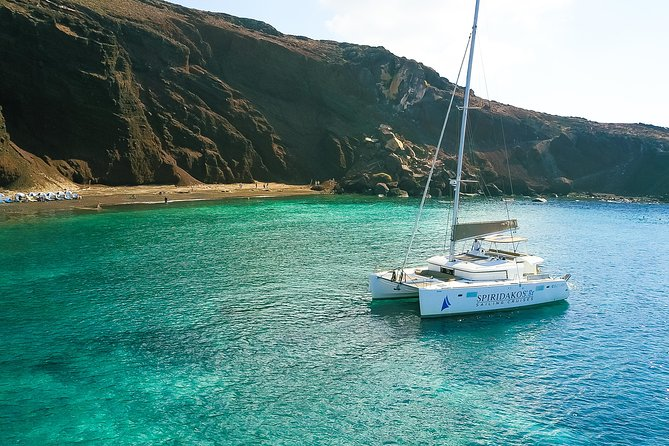 Sail around Santorini on aCatamaran during this 5-hour Cruise, departing from Vlychada Marine. Sail past the island's highlights, such as the Venetian Lighthouse, the Indian Rocks, the Red & White Beaches and the Village of Akrotiri. Stop at the White Beach for a swimming and snorkeling session and enjoy scenic views of the Aegean Sea as well as the neighbouring Greek Islands on your way back. BuffetLunch or Dinner& Open Bar on board the boat are included. Choose between Daytime or Sunset Cruise upon Booking.<br>The only different is that at the sunset option we see the sunset on board.