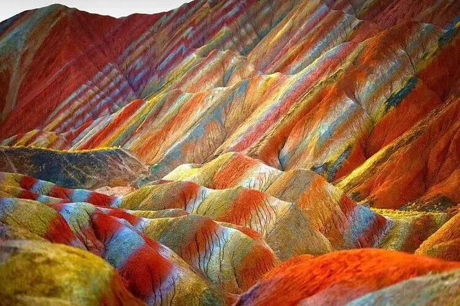 This private tour will show you to the unusual place of the Danxia park, take the private car to explore and take very good photos in the park.  <br><br>The area of Zhang in Danxia National Geopark is 510 square kilometres in total, it located in the north of Qilian mountains, SuNa County territory. It includes the colour hills in Linze country ,ice hills, Danxia and GanZhou District and PingShan lake. The scenic Danxia, is a distance of 40 km from east Zhang Ye city, north from Linze county town by 20 kilometers, this is the most typical arid area of northern China.