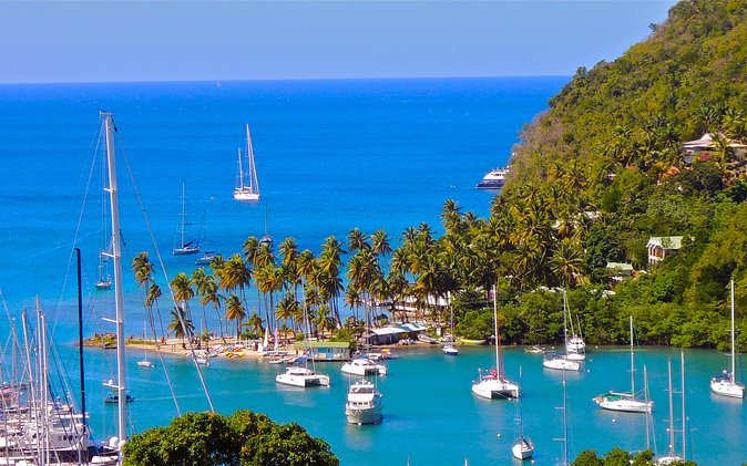 """Spend 5 to 6 hourstouring the beautiful Island of St Lucia on a private customized tour, where you can experienceeverything local the island has to offer. Here are some options you can choose from as places you can visit. (NB. Please select the most important places of your interest to indicate to your Driver / Tour Guide). Visit the Caribbean's only """"drive-in""""volcano, the twin peak pitons and the most beautiful bay in the whole Caribbean (Marigot Bay). View theGovernor General Mansion, local fishing villages, andthelargest banana plantation on the island. Enjoy beach time, waterfalls, free rum tasting, shopping, the Botanical Gardens, Tet Paul Nature Trail, Morne Coubaril and muchmore! During thetour a limited amount of refreshments will be provided for your convenience and the tour canbe customized to anything clients wish to visit that is along the way."""