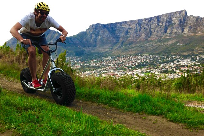 Jump on a Monster Mountain Scooter and Free Wheel into the City Below! This isa unique way to experience Cape Town's Table Mountainandit's breath taking views in a fun and active way. This 5 km track will take you on an adventurous off road track down the side of Signal Hill into Bo Kaap. The Experience continues as you are transported to Table Mountain for you final run down a single track off this world famous land mark.