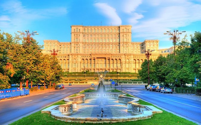Discover the top attractions and hidden secrets of the Romanian capital on this full day Bucharest tour. Stroll through the streets and squares of Bucharest and visit its main attractions: Palace of Parliament, the second largest building in the world, Romanian Athenaeum, the Village Museum and the Old town. Along the way, listen as your local guide sheds light on centuries of Romanian history. This full-day tour includes pickup and drop-off at your Bucharest hotel.
