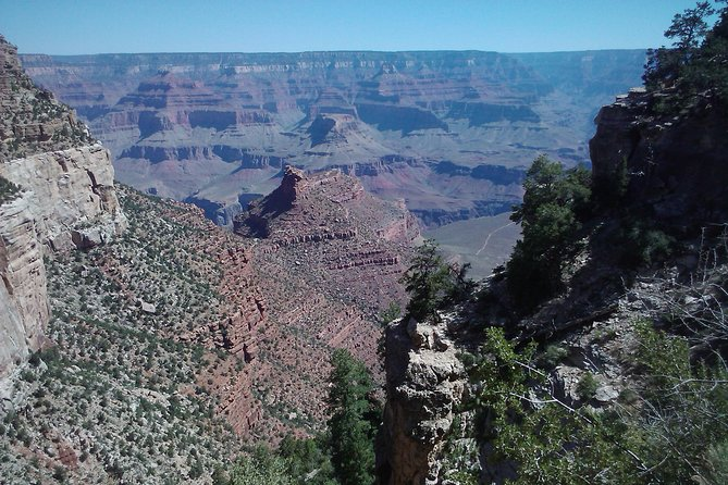 This 13 to 14 hour tour takes you to BOTH Sedona and the Grand Canyon. See Sedona and the Grand Canyon via a small group of up to five passengers maximum. This small group tour gives you a more personal and comfortable experience as you make your way through the red rocks of Sedona to the grandeur of the Grand Canyon. In Sedona, you will visit Bell Rock Vista for photos, the Chapel of the Holy Cross and a bit of time in Uptown Sedona for some unique shops and more scenery. Then on to the Grand Canyon National Park for about a 3 hour visit including 2 unique views of the Canyon at a minimum.