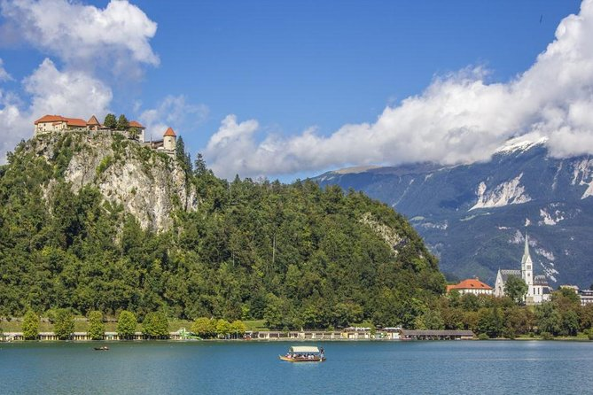 """Your visit to Slovenia wouldn't be a perftect one if you don't visit two of Slovenia's most popular attractions. Enjoy your stay in Bled in a unique way and combine Bled Castle ond Bled island in one tour. Enjoy a convenient pick - up from your hotel or from meeting point in central Bled . We will bring you to the wonderful Bled Castle, where you will have the chance to visit the museum and enjoy stunning views. You can step into a traditional """"pletna"""" boat to reach your second destination of the day, the unique island in the middle of the lake, or, depending on your time, you can first admire the amazing view from the lakeside, take coffee break or lunch time..."""