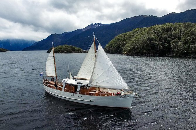 "Join us for an elegant cruise on the historic motor yacht ""Faith"" on Lake Te Anau. This relaxed 3-hour experience includes a guided walk in the Fiordland National Park, a delightful morning tea and refreshments, and cruising home under sail. You have 3 uniformed crew hosting you while on board, and 2 nature guides to show you the delights of New Zealand scenery. This option is restricted to 16 passengers to ensure a comfortable, personable experience."