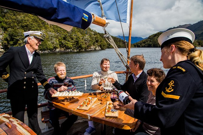 Make your way down to Te Anau's historic wharf, and step aboard an elegant vessel on this 1.5-hour champagne cruise. Pause to appreciate the beauty of the era you're about to experience and celebrate the attention to detail and fine craftsmanship of the mid 1930's. Sit back and relax as you sail into the deep waters of Lake Te Anau. Allow yourself to be treated with champagne and canapés as the ancient history and unique Fiordland landscape slide by effortlessly. Celebrate your vacation as the setting sun turns Te Anau golden, take a deep breath and connect.