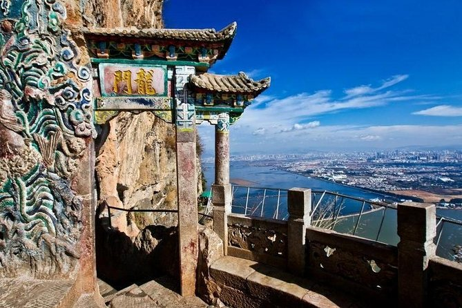 """Our tour takes place in Kunming, capital of Yunnan province and a historical and cultural city. People around China also call her """"Spring City"""" because her climate is like spring all year round. The Nationalities village is a huge park that reunites Yunnan's 26 ethnic groups and where you can learn a lot about their culture and traditions. Close by are the Western Hills, where you can visit the temples carved on the side of a natural cliff and admire a big panoramic view of Kunming and Dianchi lake. Next to the dragon gate you will also find the largest Taoist grotto of Yunnan.<br><br>Highlights:<br> • Western Hill and Dragon Grotto: temples on the side of a natural cliff, the largest Taoist grotto of Yunnan, big panoramic view of Kunming city and Dianchi lake. <br> • Nationalities Village: Learn about Yunnan's 26 ethnic groups way of life, architecture, clothing and traditions."""