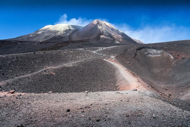 "Excursion to the highest viewpoint on Mount Etna<br><br>After a pleasant ride in our comfortable vehicles, passing the small towns of Pedara and Nicolosi and cold lava fields formed over the years, you will reach the <br><br>""Rifugio Sapienza Etna"". Here the <br><br>Emotion Etna 3000 m begins.<br><br>By <br><br>cable car you will reach an altitude of 2500 m and will eventually get up to 2900 m by <br><br>special unimog vehicles. The area you will find yourself in now, is called ""Torre del Filosofo"" at the foot of the main crater. From here you will have a stunning view over the Mediterranean, if weather permitting."