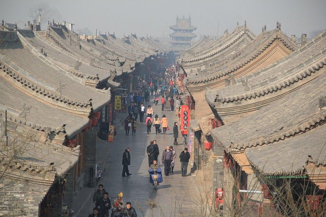 Coming to visit the real old china, Pingyao is the right and good place to see, this tour include the Pingyao ancient city visiting, and Shuanglin Temple visiting too. Walk in the main street and get into the each highlight to see the details with guide's explaining, you will learn a lot of Pingyao from past to now, this tour cover all the highlights inside the wall, economic building, religion building, city wall and pedestrian street. Don't miss to see the paper cut making nearby the Confucius Temple, so much details with good meaning and wishes. The maker is amazing and so experienced. Continue to visit the sight and guide will show you the good restaurant to have local food. And you also going to visit the Shuanglin Temple which is 1500 years old and shows about 3000 colourful statues from Song, Yuang, Ming and Qing Dynasty. These are highlights of this day trip in Pingyao.