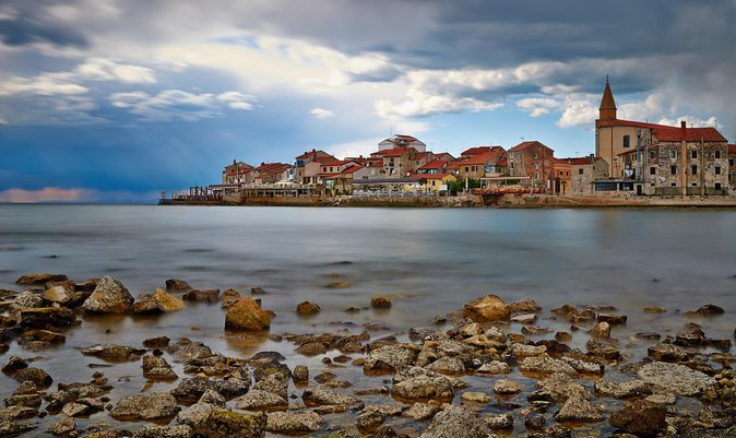 Discover Umag's food, history, architecture and culture on this 3-hour, small-group walking tour. Try six of Istria's gourmet staples from local restaurants and specialty food shops. Taste local Istrian favorites including prosciutto, pasta, cheese, and wine, just to name a few. Along the way, see and learn about the historical, cultural and architectural components that make Umag a charming Istrian gem.<br><br>Highlights<br> • Take a walking food tour of Umag<br> • Enjoy at least six tastings at local eateries<br> • Try three local Istrian wines<br> • Visit Umag's historic and cultural locations<br> • Small-group ensures a personalized experience