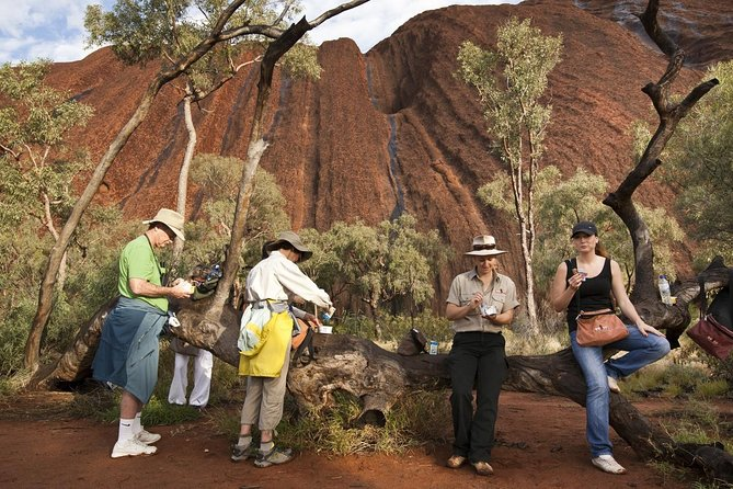 Watch sunrise from the base of the rock rather than from a viewing area further away. <br>Outback picnic breakfast including tea and coffee provided on the walk. <br>The small group* allows you to make the most of your guide. Ask as many questions as you like, hear all the stories and facts without <br>Learn about the cultural significance of Uluru to the local Anangu people.<br><br>*Due to the coronavirus all tours will will need a minimum of 6 passengers to depart and may exceed our usual maximum of 11. This is valid until the 31st October 2020.
