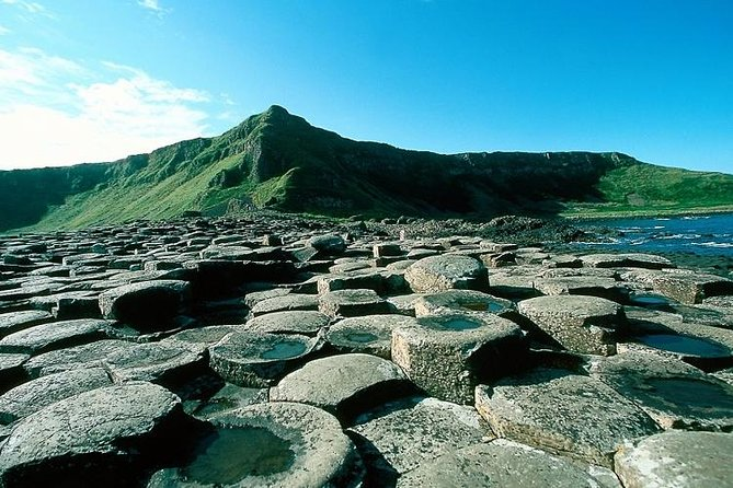 Our 1 day guided Giant's Causeway & Belfast City Tour will bring you to some of northern Ireland's most treasured sites. Sit back relax and enjoy the wonderful views of the Causeway Coastal Drive. Find the courage to cross the Carrick-a-Rede rope bridge and take in some of the most beautiful sea cliffs along the causeway coast. Experience the wonderful land and seascape of the world famous Giant's Causeway, one of one two UNESCO world heritage sites on the island of Ireland. Visit the vibrant city of Belfast with the option to take the famous political taxi tour with a local guide.