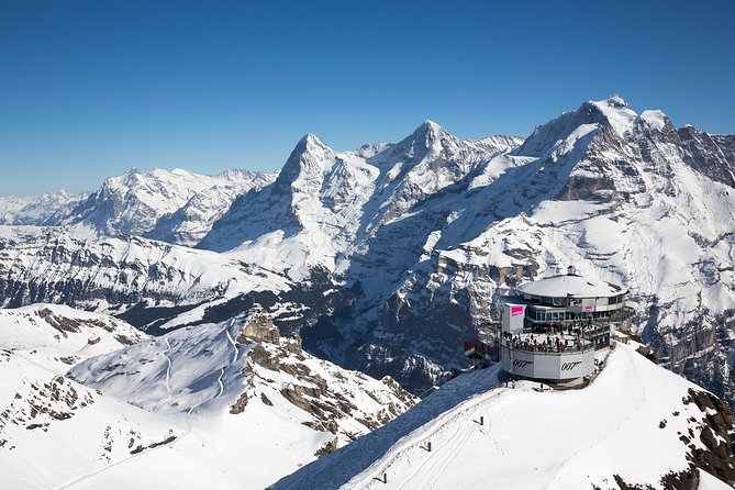 After a short trip of just 30 minutes by aerial cableway you'll reach Schilthorn - Piz Gloria. <br><br>The view from the spacious observation deck on the 2970-metre-high Schilthorn summit is breathtaking in the truest sense of the word. Surrounded by a magnificent array of peaks like pearls on a string, you can feast your eyes on more than 200 mountains from here. Nowhere else is the view of the UNESCO World Heritage site with the Eiger, Mönch and Jungfrau more stunning. <br><br>This ticket also allows you to visit the 360° Restaurant Piz Gloria, Bond World and the Thrill Walk.