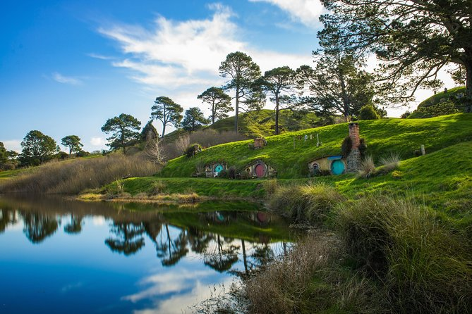 Experience the real Middle-earth™ at the Hobbiton™ Movie Set, where, in the heart of the Waikato region, you can step into the lush pastures of the Shire™, as seen in The Lord of the Rings and The Hobbit trilogies.<br><br>Fall in love with the Alexander family sheep farm, just as acclaimed director Sir Peter Jackson did, as you journey through the unequivocal beauty of the land with the mighty Kaimai Ranges towering in the distance. Your guide will escort you around the set, showing the intricate detailing, pointing out the most famous locations and explaining how the movie magic was made. You will be fully-guided around the 12-acre set: past Hobbit Holes™, the Mill and into the world-famous Green Dragon™ Inn where you will be presented with a complimentary, exclusive Hobbit™ Southfarthing™ beverage to conclude your own Middle-earth™ adventure.