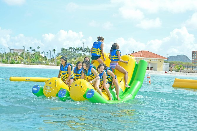 Experience something unique and take an exciting voyage to Surfside Beach.We will make a little City tour in the downtown area, where you will see the live and colorful One Happy Island.<br><br>After this you will experience the one and only water park in Aruba located on the exclusive location of Surfside Beach. When you are done with the fun in the sun you can take one of our exclusive floating beds called Ocean Floats and just lay down and float in the water while you hear the waves whisper your ears. Filling thirsty during this time? Don´t worry, refreshments are included and a snack to boost you up as well. At the end of the Water Surfside Beach experience we will take you back to your pick-up point so you can continue your day.