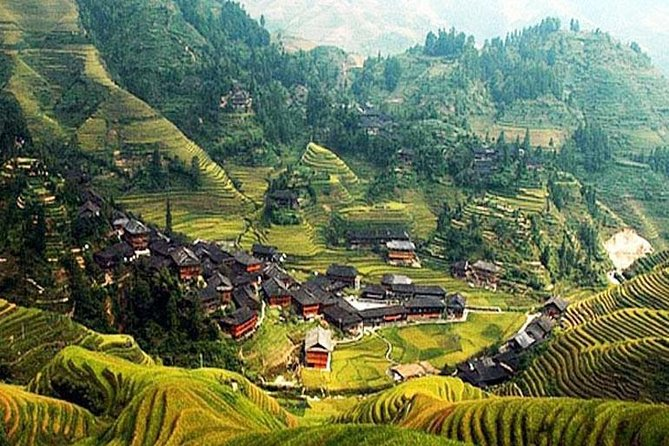 Take a private day trip from Guilin to Longsheng to discover China's rich minority culture. Interact with the Zhuang and Yao people in Longsheng and learn about their traditions. Trek up to the famous Longji Rice Terraces and admire the panoramic view. The terraces resemble great chains of ribbons as they wind from the foot of the hill to the top. It's one of China's most scenic natural sights!