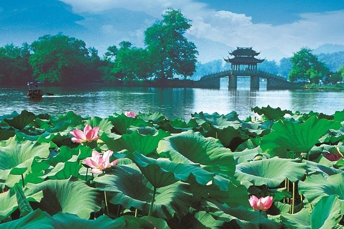 Take in a full day of Hangzhou's elegant landscapes on this sightseeing tour with a local guide. Explore Lingyin Temple, a secluded Zen retreat near Feilai Peak (Feilai Feng), then rest in the shade of a tea pavilion at Dragon Well Tea Plantation and enjoy a boat ride over picturesque West Lake. Finish at Red Carp Pond and Flower Harbor Park, where fish, birds and peonies abound. Round-trip hotel transport by comfortable coach.