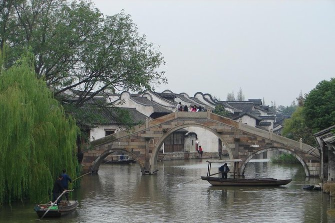 Escape the busy Hangzhou crowds and discover Wuzhen's rich cultural background on this full-day coach tour. Explore the picturesque water town with its stone pavements winding between antique buildings and ancient stone bridges crossing scenic water pathways. Visit several attractions with your guide, including the Hundred-Bed Museum and a blue-print fabric workshop to see popular antiques. Enjoy an authentic Chinese lunch, witness the town's dynamic culture at the Sanbai Wine Workshop and enjoy a performance of shadow puppetry. Relax and enjoy a boat ride(optional) on the river.