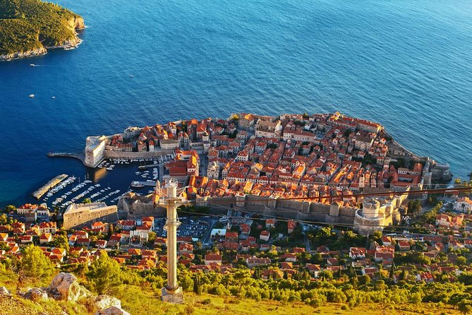 Save on two must-experience Dubrovnik tours with a Super Saver that combines a Mt Srđ cable car trip with an Old Town and city walls walking tour! Ride up in the cable car with a guide, and gaze down at the glorious Dalmatian Coast and city of Dubrovnik from the peak of the famous mountain. Ride back down into the city and explore Dubrovnik's Old Town and UNESCO-listed city walls, discovering the history of top city attractions such as Sponza Palace, Church of St Blaise, Minčeta Tower and more.