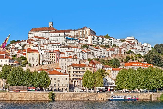 """Enjoy the """"enchanted and fantastic city of Coimbra"""" on an open-top double-decker bus which takes you to the most beautiful locations, the most striking look-out points and the top historical sites. <br><br>The tour takes one hour and includes an audio guide which will provide you with the best and most accurate information about the city, its history and traditions only with Yellow Bus Coimbra."""