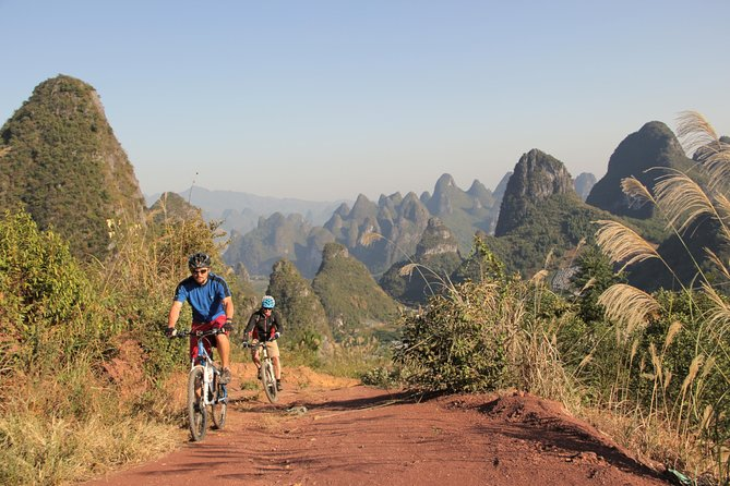 Experience the stunning scenery of rural Yangshuo on a 5 day/ 4 night bike tour, perfect for those with a desire to see more the more untraveled side of the region! Enjoy several moderate bike rides with your guide through karst mountains and rice fields, along high ridge-lines, orchards and bamboo-lined rivers. Take a rafting trip down the Li River, explore local markets in BaiSha and enjoy an additional activity of your choice: rock climbing, cave exploring or even a cooking class. Round-trip luggage transportation, airport transfers and excellent bike are included. You'll stay overnight in rural villages, giving you a genuine Chinese countryside experience!