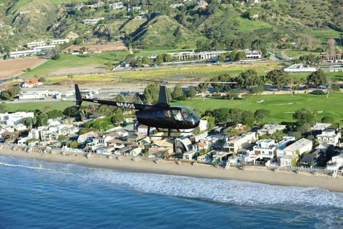 Treat your special someone to a romantic helicopter flight over Los Angeles. This 45-minute flight is full of sightseeing, one-of-a-kind views of Los Angeles' favorite landmarks and the stunning California coastline. Plus, you'll get an exclusive landing on top of a secluded peak in Malibu overlooking pristine beaches and the Pacific Ocean. <br><br>Dessert, roses and Champagne are included, so bring along your significant other and fall in love all over again on this romantic helicopter flight over Los Angeles.