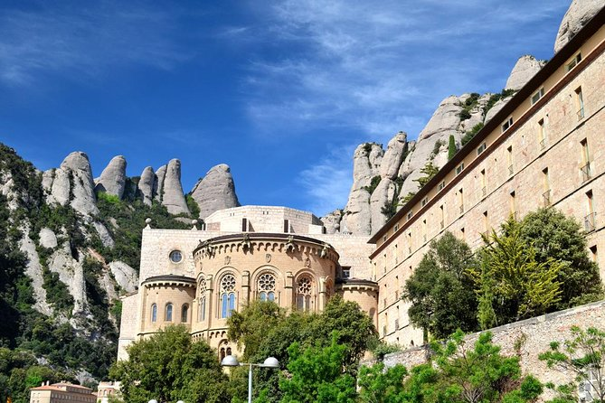 Explore majestic Montserrat and the Montserrat Monastery on this day trip from Costa Brava. Take a cogwheel train ride up Montserrat, a unique multi-peaked mountain in the outskirts of Barcelona, and visit the Montserrat Monastery, an important pilgrimage site in Catalonia. Inside, see the famous 12th-century carving Our Lady of Montserrat, also known as La Moreneta (the Dark One), and listen to the children's choir. Upgrade to include a visit of the Museum of Montserrat, where you can learn about Montserrat's role as a spiritual and cultural center and admire art from Picasso, Dalí, Monet, and more.