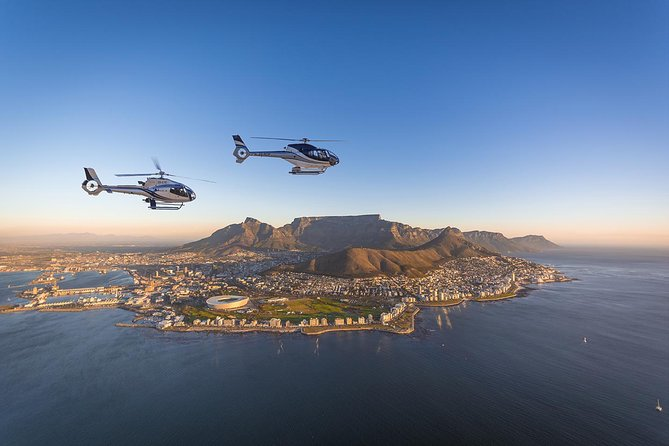See two oceans in one helicopter trip on a scenic flight from Cape Town! On a route around beautiful Table Mountain, glide along the Atlantic coastline and cross the Cape Peninsula through Sun Valley to reach the waters of False Bay. See contrasting landscapes around the different stretches of coast, from the craggy peaks of Signal Hill to the sandy shores and lavish houses at Camps Bay.