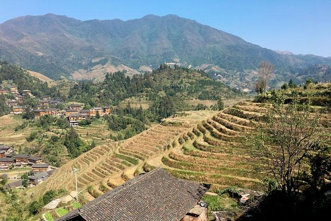It takes 3 hours to visit Longsheng Rice Terraces from Guilin or Yangshuo.  So you'd better stay overnight in village for more photo oportunities. The hotel of Quanjinglou is the best available there, it is located on the summit of the mountain. Round trip bus transfers between airport, railway station, or hotels in downtown Guilin are included. <br><br>This is a combination package of airport or railway station pickup, transfers, admission tickets, hotel accommoation. No tour guide service is included. It is designed for camera men.