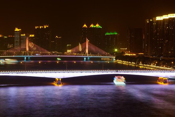 Let the magical beauty of the Pearl River enchant you on a night cruise in Guangzhou. You'll be captivated by the romantic atmosphere as you admire the sparkling lights of the city skyline. A private guide will accompany you and share interesting tidbits about the sights along the way. From White Goose Pool to either Guangzhou Bridge or White Crane Cave, you'll pass under ten bridges and view famous landmarks illuminated at night. Your tour includes a walk along the waterfront and round-trip hotel transport by private vehicle.