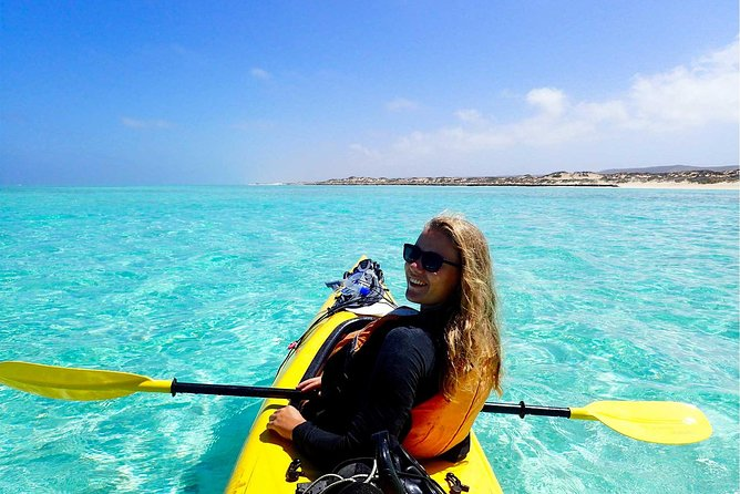 Sea kayaking is a fantastic way to explore the sheltered lagoons and beautiful beaches of Ningaloo: you can paddle into paradise and leave the crowds behind. <br><br>Imagine gliding over pristine turquoise waters with only the sounds of nature around you. Stopping to snorkel beautiful sites, either from the beach or from your kayak, with your guide at your side.<br><br>Along the way you'll look for turtles, rays, schools of fish, and coral life from your kayak. You may even see dugong (May to July) and dolphins. <br><br>Small group sizes means our guides can personalise the tour to their guests, to make your experience unforgettable. We usually have a maximum of 8 guests on this tour, but for large groups can accommodate 16.<br><br>Enjoy the contrasting scenery of reef and range that this UNESCO World Heritage-listed area offers - all from the best seat in the house.