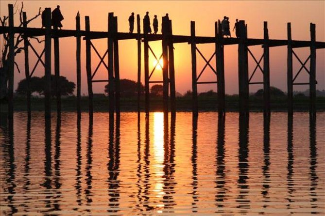U Bein Bridge is one of the most recognizable places in Myanmar, and makes for a great evening trip from Mandalay so you can capture the beauty of its structure at sunset. Relax along the riverbanks and want the shore, water and bridge come to life with visitors and locals admiring the nightly setting of the sun.
