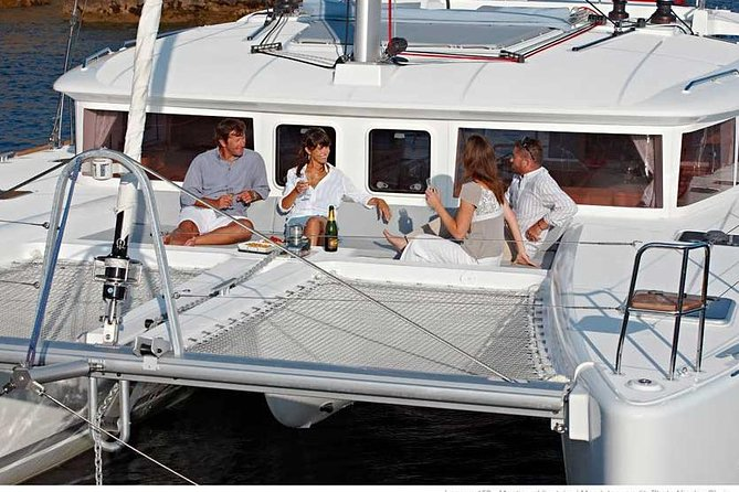 Experience the beauty of Santorini and its volcanic caldera on this small-group sailing tour. Cruise by some of the island's best-known landmarks before venturing into the turquoise waters of the caldera. Enjoy asoothing dip in the island's hot springs, and slip on your snorkels and masks for a snorkeling session. Finish up the excursion with a seafood and barbecue feast, washed down with local wine or beer. When you book, choose between a Day Touror a Sunset Tour.