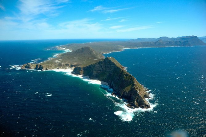 With this Cape Town Super Saver you'll get two best-selling tours at one discounted price, combining Cape Point with a Stellenbosch wine tour. Experience the Cape's highlights in one day and mix relaxing sightseeing with a little wine tasting for the perfect day out.<br><br>The Cape is an area renowned internationally for its spectacular natural scenery. Craggy mountain peaks contrast with endless ocean vistas and lush green valleys.<br><br>Set off out of town along the Atlantic Seaboard, with fantastic coastal views as you cruise past prime real estate. Make your way through Hout Bay to enjoy world-famous views along Chapman's Peak Drive, then journey to Cape Point, at the edge of Africa, to enjoy views unlike any other. Cape Point is also part of the Cape Point Nature Reserve, rich in flora and fauna. Proceed to Stellenbosch in the heart of the mountainous Cape Winelands and enjoy an orientation tour of the town before sampling a selection of top-class wines at a beautiful, local wine estate.