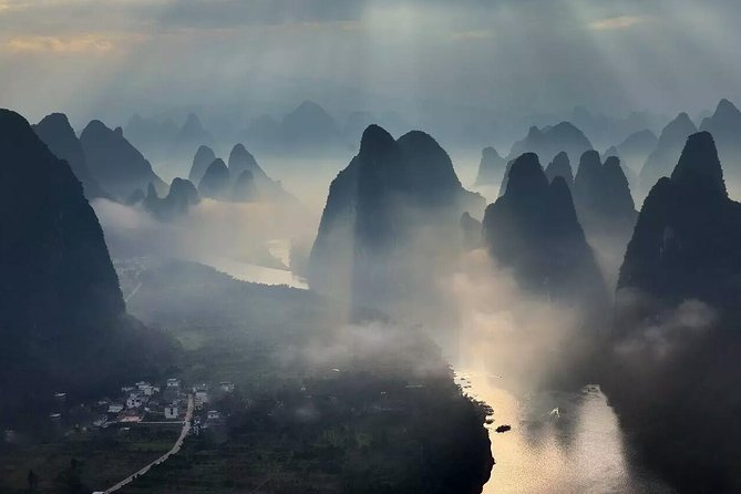 Explore the beautiful Yangshuo region during this full-day private tour from Guilin. Take in the views from the Xiangong Mountain, visit a local farmer's market, cruise down tributaries of the Li River on a bamboo raft, explore small villages, and more. This tour is a great opportunity to explore more of the natural beauty of the Guangxi province in a short amount of time. <br><br>Take a full-day private tour from Guilin to the Yangshuo region<br><br>See the Xiangong Mountain and take in the views of the Li River <br><br>Cruise down Yulong river in a bamboo raft and visit a local market<br><br>Explore Silver Cave, the representive limestone cave in this Karst region<br><br>Enjoy a personalized experience with a private guide and vehicle<br><br>